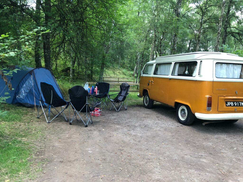 vw campervan in scottish glade